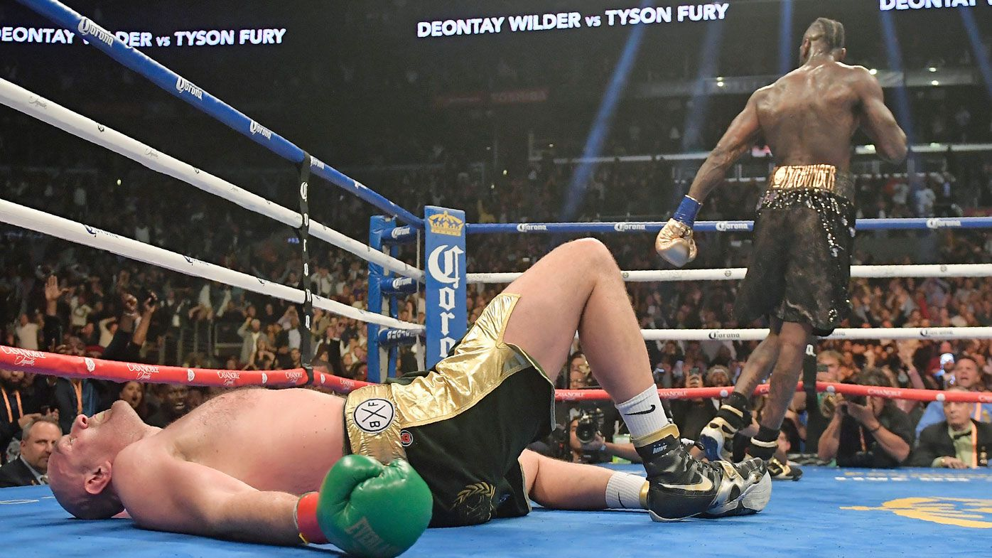 Fury knocked down by Wilder