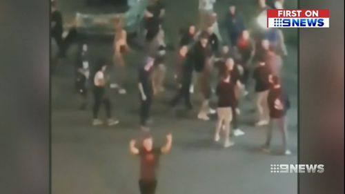 """""""F--k the police"""" people were filmed yelling. (9NEWS)"""