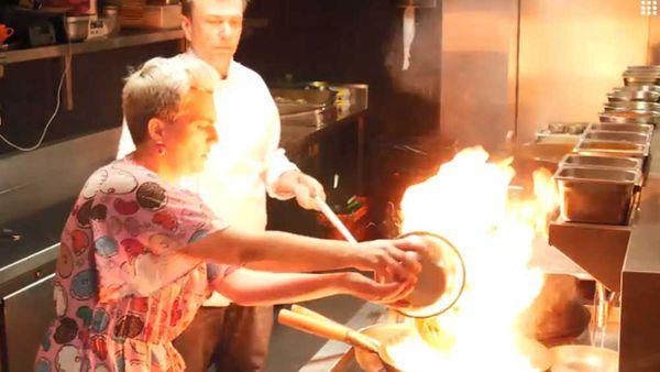 Chef David Thompson shows food writer Jane de Graaff how to stir-fry