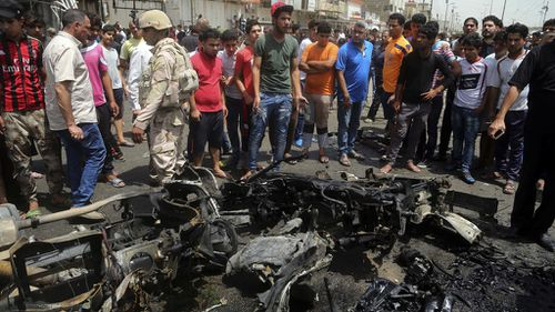 ISIL claims bomb attack at crowded Baghdad market that killed 64