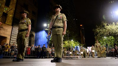A member of the catafalque party stands guard during the Anzac Day dawn service in Sydney. (AAP)