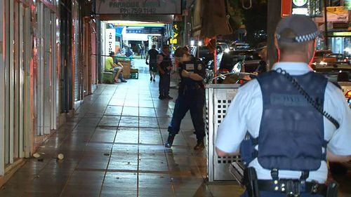 Police seperated 10 men, allegedly brawling in the street in Sydney's southwest. (9NEWS)