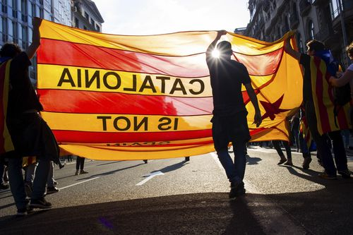 People demonstrate at the University square, in downtown Barcelona, (AAP)