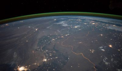 The winding border between India and Pakistan can be seen at night, thanks to orange security lights. Image taken September 23.