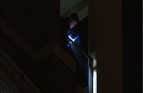 Emergency services had to determine the teens injuries where he landed 11-storeys up. Image: 9News
