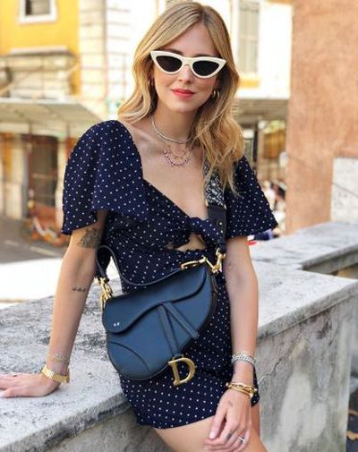 Style blogger Chiara Ferragni ( The Blonde Salad) with a Dior Saddle Bag