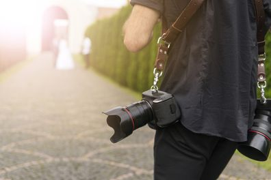 Wedding photographer follows bride and groom
