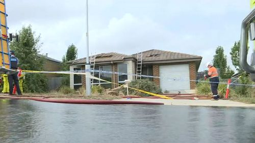 The bodies of two children and one adult were found in the smouldering ruins of the home. (9NEWS)
