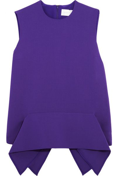 "Victoria by Victoria Beckham stretch-wool crepe peplum top, $575 at <a href=""https://www.net-a-porter.com/au/en/product/750206/victoria__victoria_beckham/draped-stretch-wool-crepe-peplum-top"" target=""_blank"">Netaporter.com</a><br>"