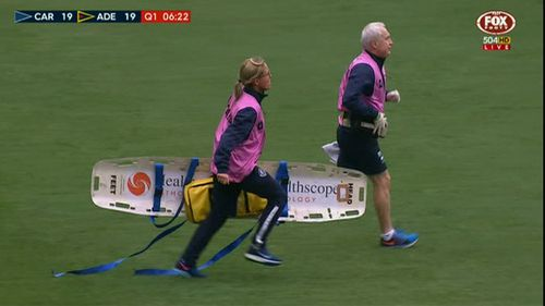 Medics run onto the pitch. (9NEWS)