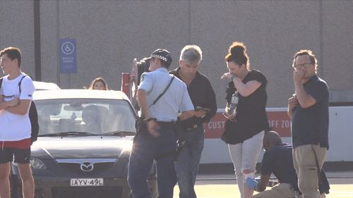 Police investigate the circumstances surrounding the carjacking after the incident.