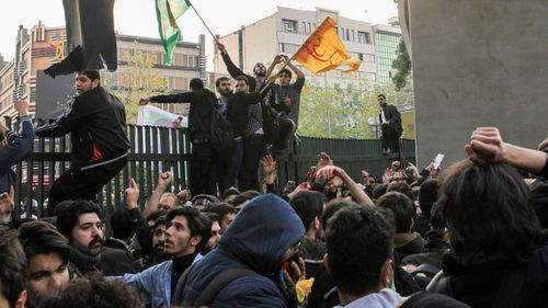 People gather to protest over high cost of living in Tehran. (Getty)
