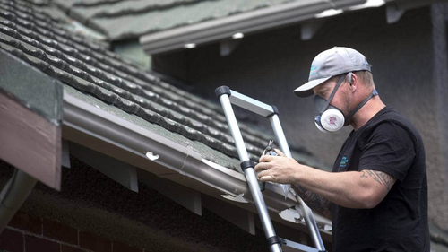 Betta Inspect It building inspector Craig O'Keefe checks hail-damaged roofs in Christchurch for asbestos