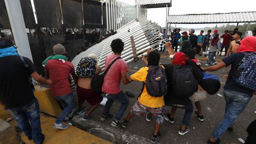 Central American migrants of the second caravan confront the police in Tecun Uman, Guatemala. Thousands of migrants broke through the border fence between Guatemala and Mexico and crossed to Mexican territory.