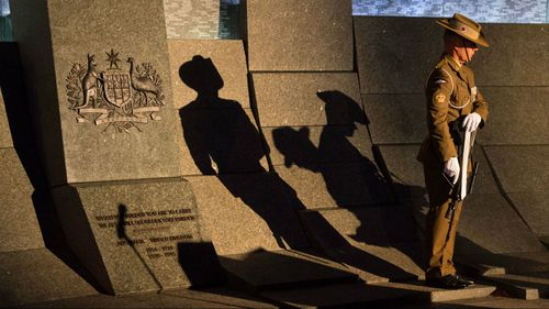 A soldier during an Anzac Day dawn service at the Australian War Memorial at Hyde Park Corner in London. (AAP)