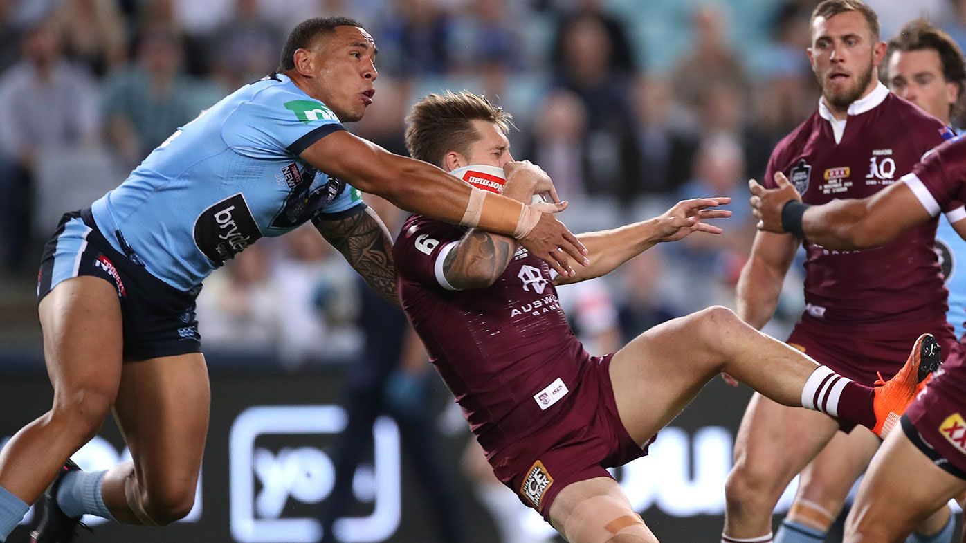 Cameron Munster of the Maroons and Tyson Frizell of the Blues compete for the ball during game two of the 2020 State of Origin series