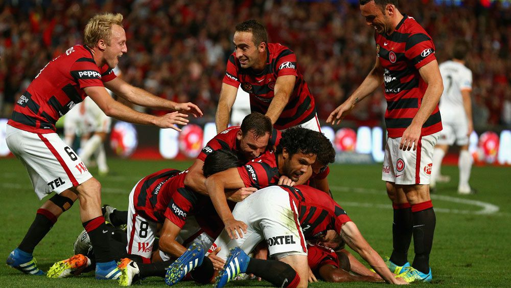 Wanderers players celebrate after a Romeo Castelen goal. (Getty)