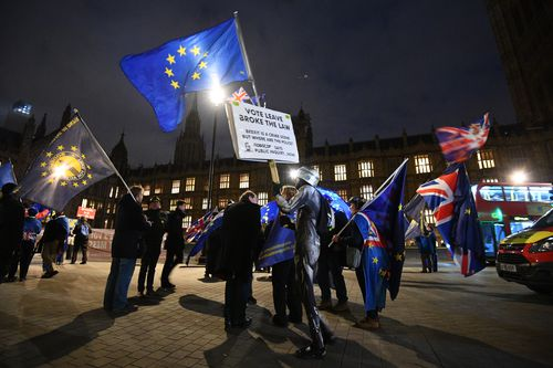Protesters outside the Houses of Parliament ahead of the final day of debate before the Brexit deal goes to a vote.