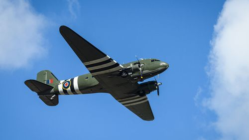 A vintage C-47 Dakota performs a flypast over Bedford crematorium as a funeral service for Sir Tom Moore takes place on February 27, 2021 in Bedford, England