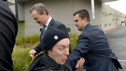 Mr Pyne is escorted inside by security. (AAP)