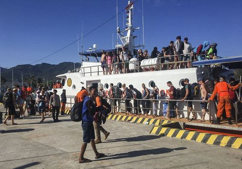 Thousands of desperate tourists have been trying to access ferries away from the islands. Picture: AAP.