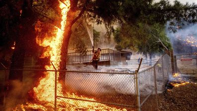 Capt. Jesse Campbell works to save the Louis Stralla Water Treatment Plant as the Glass Fire burns in St. Helena.