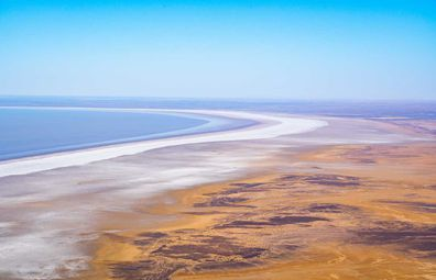 Lake Eyre's salty shoreline looks like the rings of Saturn.