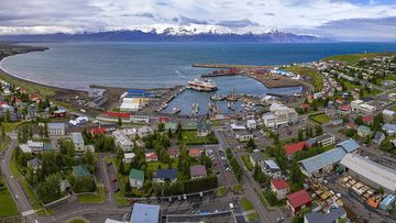 Aerial panorama of Husavik town and the harbour.