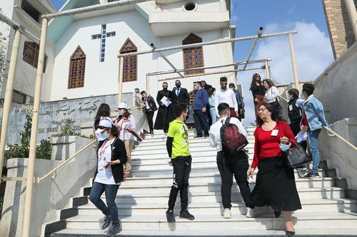 Iraqi Christians gather at the Church of the Virgin Mary before going to the airport to welcome the Pope in Baghdad, Iraq, Friday, March 5, 2021