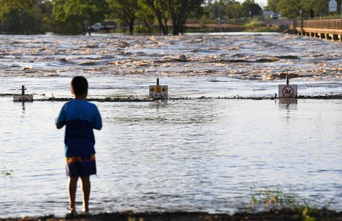 The swollen Balonne river gushes under the Jack Taylor weir in St George, south-western Queensland.