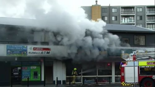 Man rescues five people from units above burning Sydney dollar shop