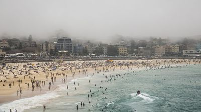 As Sydney's west sweltered, the iconic Bondi Beach was blanketed under a rare sea fog today. (Photo: Diimex)