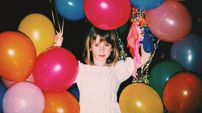 An adorable birthday girl poses with dozens of balloons in this gorgeous throwback pick from a musical icon and Nine celeb.