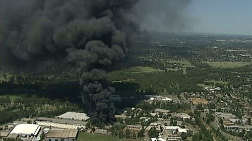 Plumes of black smoke fill the sky above the factory. (9NEWS Choppercam)