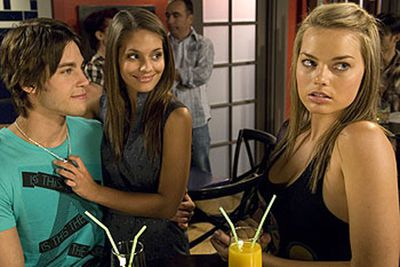 Deciding to leave <i>Neighbours</i> in 2010 to pursue opportunities in Hollywood, she lived in LA with <i>Neighbours</i> co-star and <i>Reign</i> actress Caitlin Stasey.<br/><br/>(Image: Dean, Caitlin and Margot in a still from <i>Neighbours</i> / Ten Network)