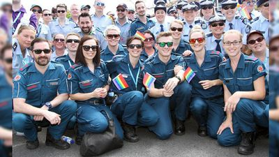 Paramedics and police officers marched in the Brisbane Pride Festival 2015. (Instagram / @qldambulance)