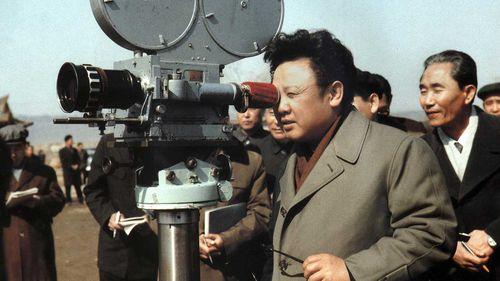 Kim Jong-il looks into a film camera in 1979. (AP)