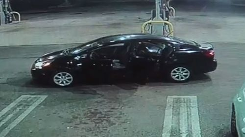 The thief was seen struggling to get the baby in the car seat out of the car he'd stolen. Picture:  WPTV