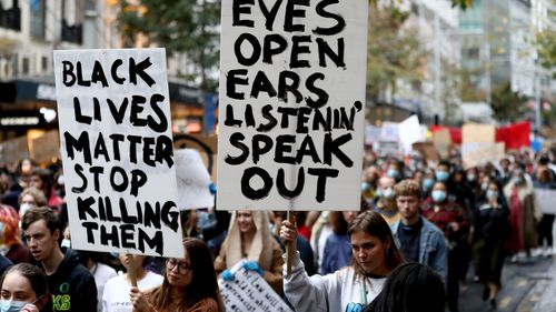 Protestors march down Queen Street on June 01, 2020 in Auckland, New Zealand. The rally was organised in solidarity with protests across the United States.