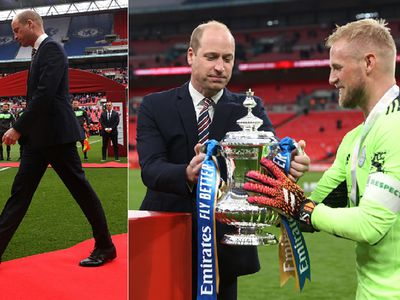 Prince William hands over the Emirates FA Cup trophy to Kasper Schmeichel of Leicester City presentation.