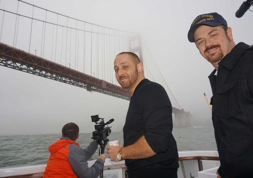 Kevin Hines (centre) with the coastguard who pulled him from the water after he jumped from the Golden Gate Bridge in September, 2000. (Supplied)