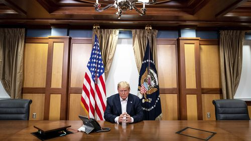 Mr Trump is framed by both the US flag and America's presidential flag during the phone call.