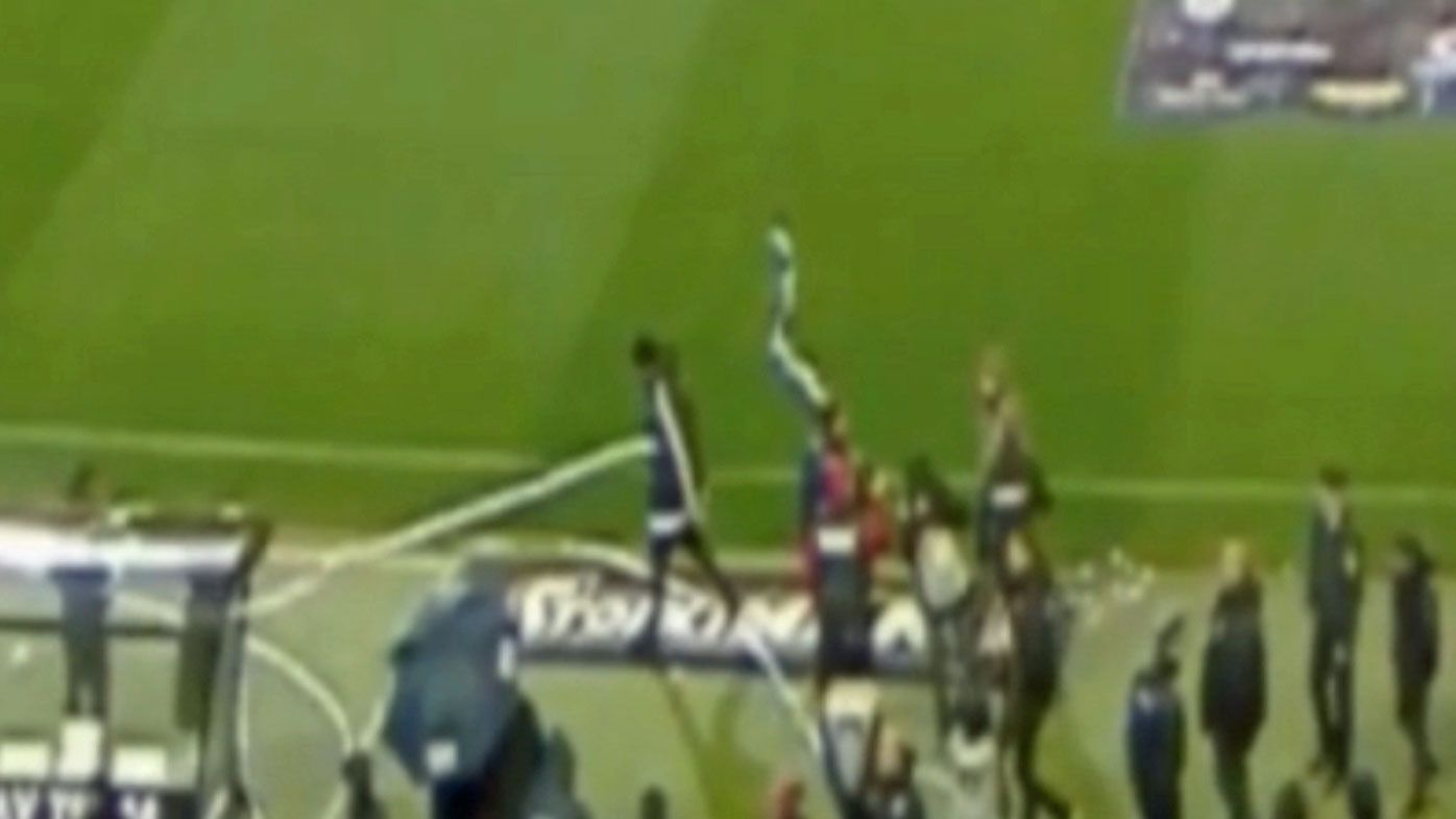 Greek football match abandoned after Olympiakos coach Oscar Garcia hit by paper