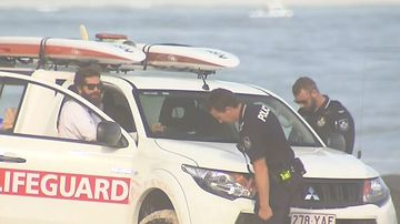 Police attend the scene where a surfer drowned this morning.