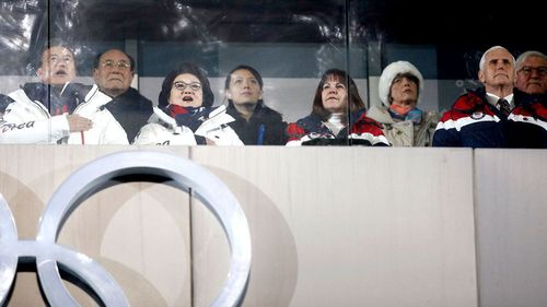 Kim Yong Nam, the 90-year-old president of the Presidium of the North's Parliament, third from left in the back and Kim Jong Un's sister Kim Yo Jong, centre, observe with South Korean President Moon Jae-in, front left, first lady Kim Jung-sook and second lady Karen Pence, and United States Vice President Mike Pence during the opening ceremony of the 2018 Winter Olympics in Pyeongchang, South Korea. (AAP)