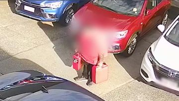 The new footage shows two men loading multiple fuel containers into the rear of a dark blue Kira Cerato hire car with registration 089YQR.