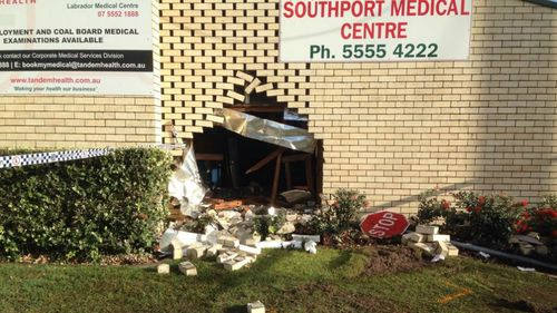 A hole left in the wall of the Southport Medical Centre, where the car crashed. (Brendon Wolf, 9NEWS)
