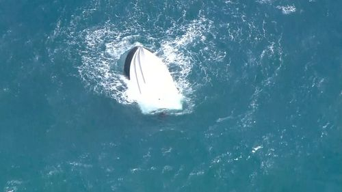 Three men rescued after their boat overturned near Mandurah