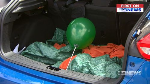The heartless thief snatched all the presents from the family's car boot.