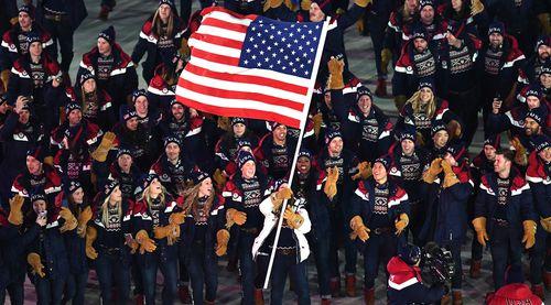 US flag bearer Erin Hamlin leads the US team into the stadium. (AAP)